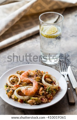 Seafood with stewed vegetables and cuscus - stock photo
