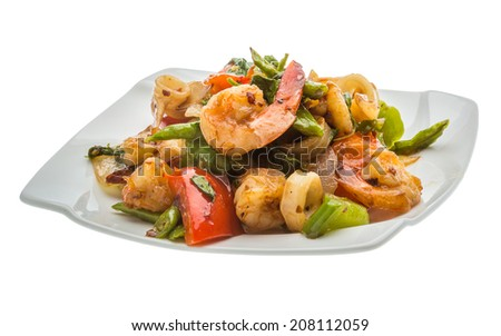 Seafood with vegetables - shrimps and calamari - stock photo