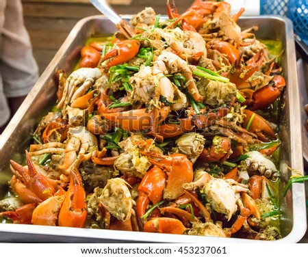 Seafood with Yellow curry sauce, sauteed seafood contains fish, shrimp, mussels, squid, crab claw, yellow curry powder, fresh garlic, egg, bell pepper, white onions, green onions celery - stock photo