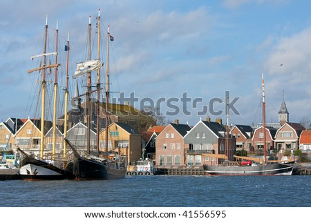 Seafront of Urk, an old Dutch fishing village. - stock photo