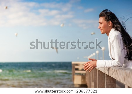 seagull watching businesswoman looking far - stock photo