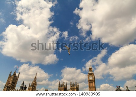 Seagulls flying in front of the Houses Of Parliament, London,UK. - stock photo