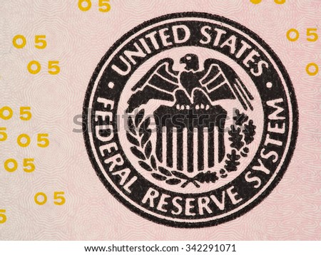Seal of the Federal Reserve System on the us  5 dollar bill macro, united states money closeup - stock photo