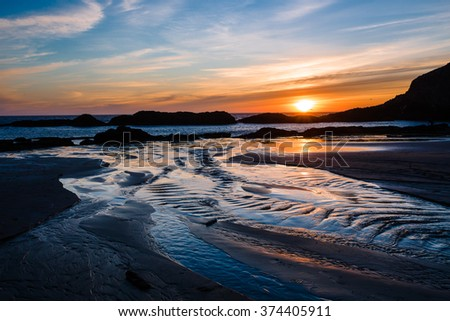 Seal Rock Beach with it's massive rocks at sunset on the Oregon Coast. - stock photo