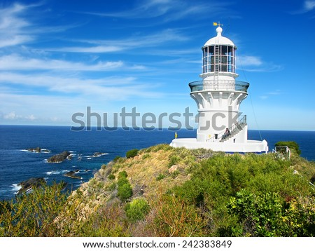 SEAL ROCKS, AUSTRALIA - JUNE 27: The Sugarloaf Point Lighthouse on June 27, 2006 in New South Wales, Australia.  It was built in 1875 and is now part of Myall Lakes National Park. - stock photo