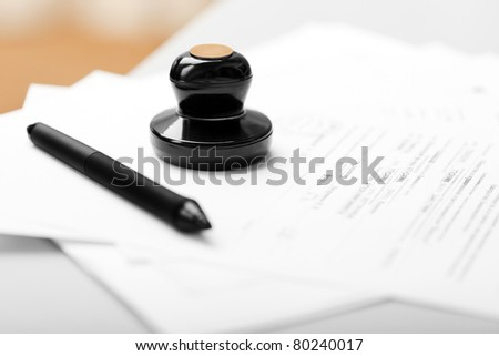 Seal stamp and pen writing business paper document - stock photo