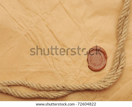seal wax and rope on old paper background - stock photo
