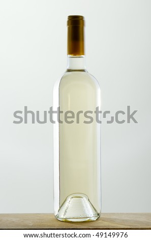Sealed bottle of white wine without label