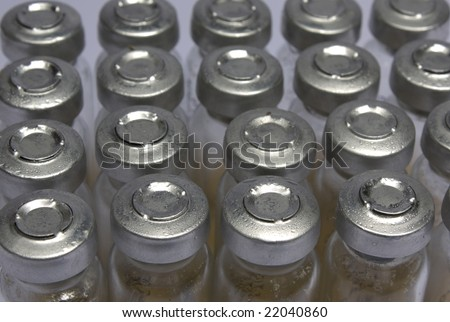sealed test tubes with bacteria stand beside, top view - stock photo