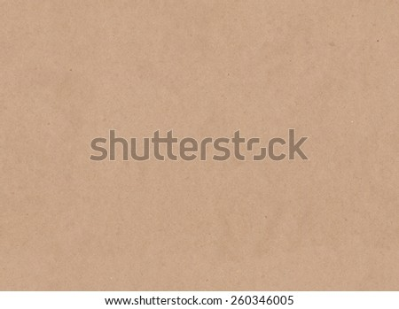 Seamless background of brown craft paper texture. - stock photo
