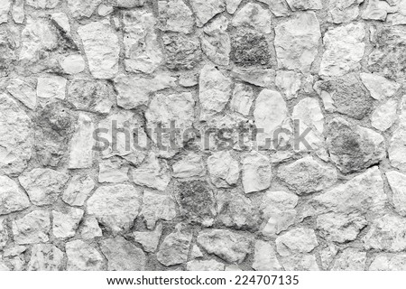 Seamless background texture of white old stone wall - stock photo