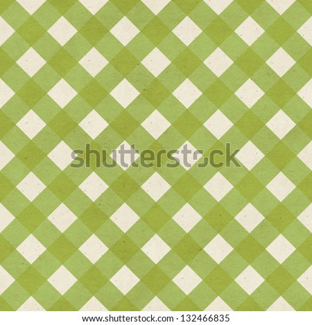 Seamless checked fabric pattern on paper texture. Geometric background - stock photo