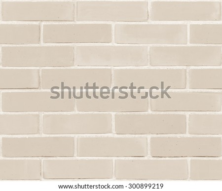 Seamless design vintage style sepia brown cream tone brick wall detailed pattern textured background: Seamless retro grungy brickwork masonry detail backdrop in light sepia creme brown color tone    - stock photo