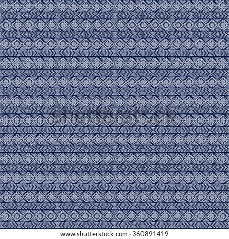 Seamless ethnic geometric pattern. Blue and white graphics, diamonds, triangles and zigzags on a white background, folk ethnic motives. - stock photo