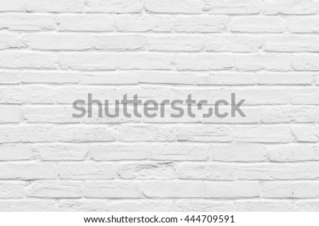 Seamless irregular natural old brick wall painted white.
