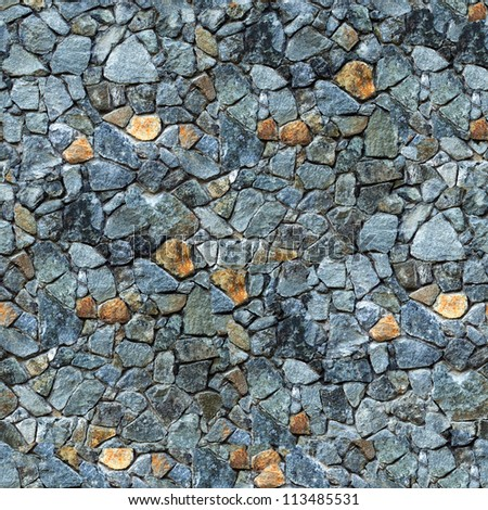 Seamless masonry wall closeup background - texture pattern for continuous replicate. - stock photo