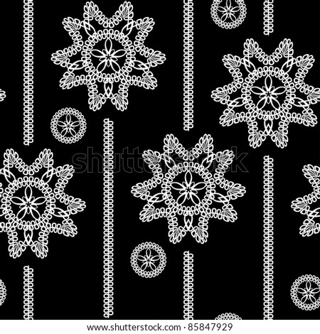 seamless monochrome background with white lace floral pattern on a black background