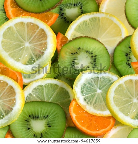 Seamless pattern from sliced fruits - lemon, kiwi, mandarin - stock photo