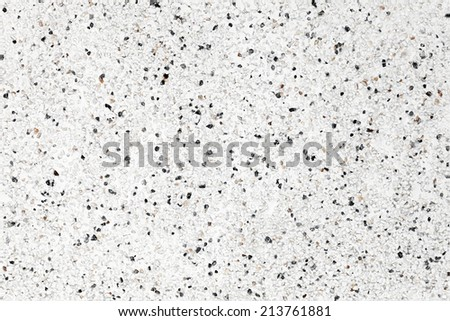 Seamless photo background texture of wall with decorative stucco and small stones - stock photo