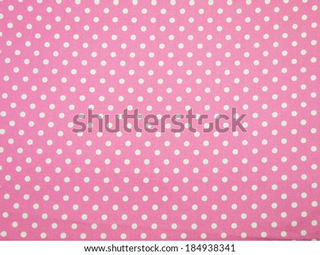 Seamless pink and white polka dot fabric background - stock photo