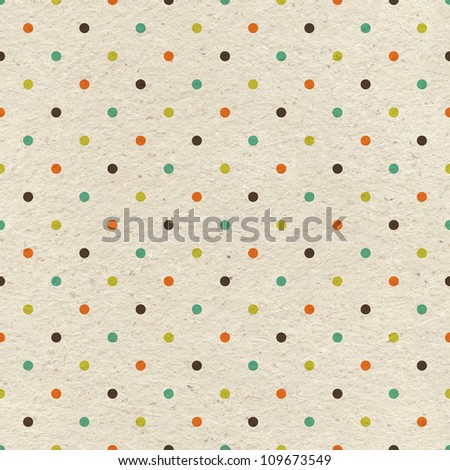 Seamless polka dots pattern on vintage paper texture - stock photo