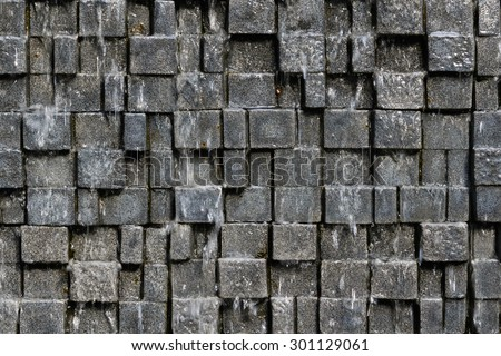 Seamless stone wall background with the motion water fall blur - texture pattern for continuous replicate