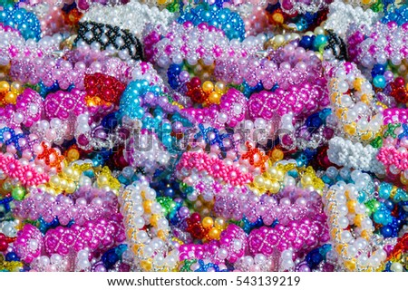 Seamless texture, background. Women's beads. Wear around the neck decoration in the form of beads strung on a thread or another form of small items.