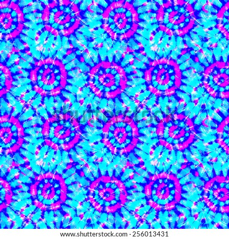 seamless tie dye effect pattern. circles and rays in blue and pink. ethnic coloring technique.  - stock photo