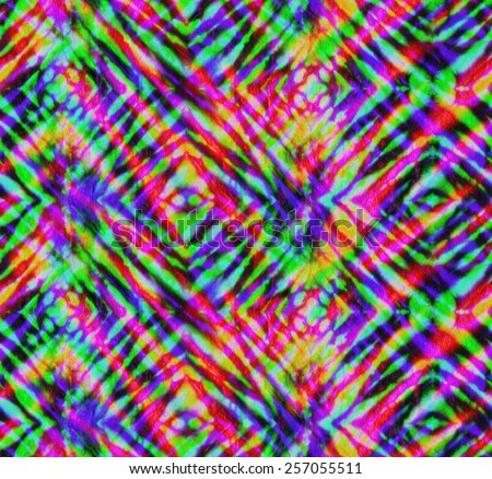 seamless tie dye pattern. colorful layered neon stripes, checks and rhombus. geometric tie dye pattern.  - stock photo