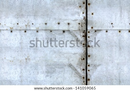 seamless tiled scratched metal texture with rusty bolts - stock photo