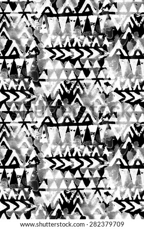 seamless tribal pattern with geometric motifs and splashes of color. ethnic design, ornamental details. black and white, monochrome palette. for fashion or interior - stock photo