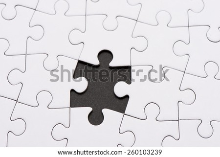 Seamless white puzzle piece background pattern with one piece missing. Conceptual image of connection, solution and business strategy. - stock photo
