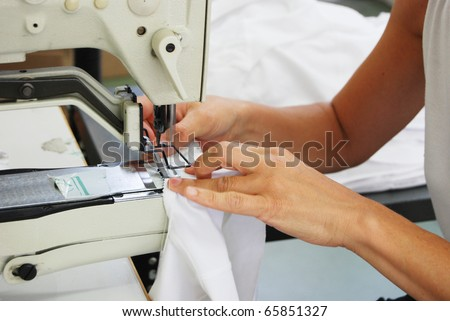 Seamstress at work in a factory of knitted underwear