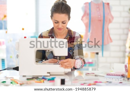 Seamstress sewing in studio