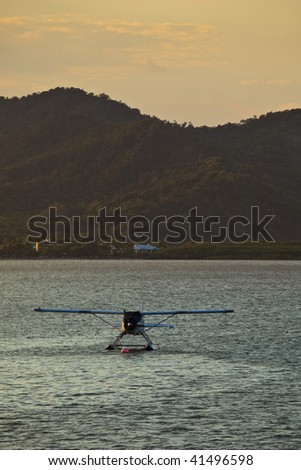 Seaplane Moored in Cairns Harbor Great barrier Reef - stock photo
