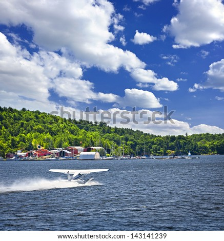 Seaplane taking off from Georgian Bay at Parry Sound Ontario Canada - stock photo