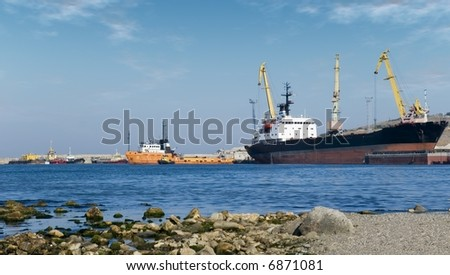 Seaport. The moored vessels in picturesque Atlantic to port - stock photo