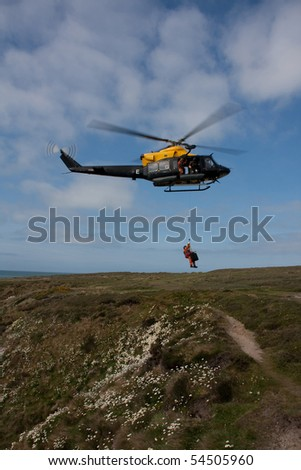 Search and Rescue Exercise on the Anglesey coastline of North Wales with a winchman learning how to  help people in distress