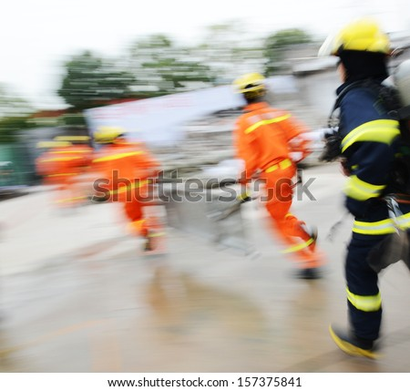 Search and rescue forces search through a destroyed building. blur motion  - stock photo