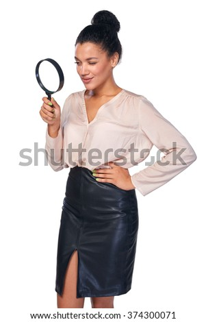Search concept. Confident business woman looking through magnifying glass at blank copy space, isolated over white - stock photo