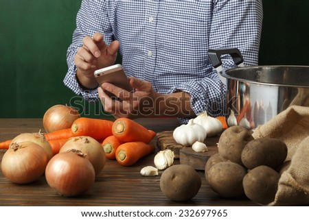 Search for recipes in the Smartphone - stock photo