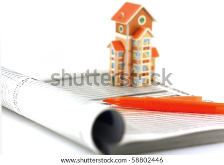 Search real-estate with help of the catalog. Shallow DOF. - stock photo