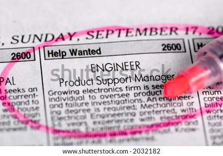 Searching for a new job in a local paper....maybe this one. - stock photo