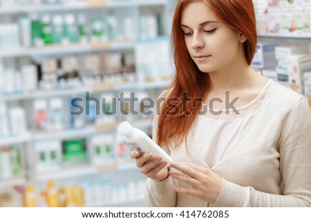 Searching for the best. Horizontal shot of a beautiful young woman shopping medicine at the pharmacy. - stock photo