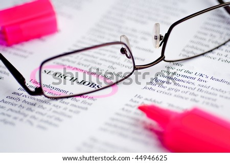 Searching job with newspaper and glasses - stock photo
