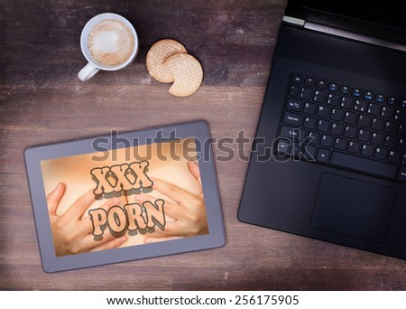 Searching online for porn on a tablet - stock photo