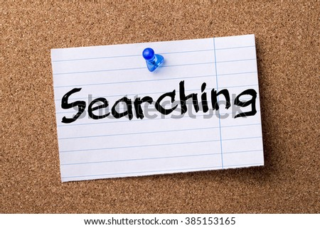 Searching - teared note paper pinned on bulletin board - horizontal image - stock photo