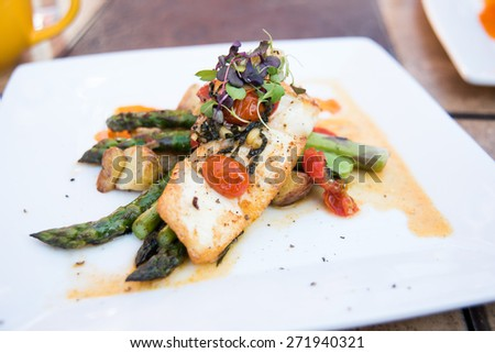 Seared Halibut with Asparagus and Potatoes  - stock photo