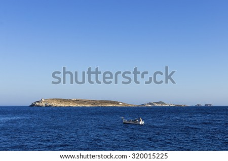 Seascape and a small fishing boat in Kimolos island, Cyclades, Greece