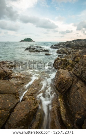seascape and motion of wave with stone and beautiful sky